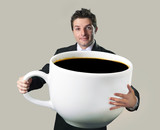 businessman holding oversized cup of black cof