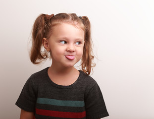 Fun kid girl showing the tongue with happy look