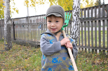 Boy with rake smiling