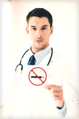 male doctor holding no smoking sign