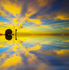 Sunset and reflection with ship radar silhoutte