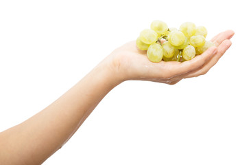 green grapes in a hand on a white background