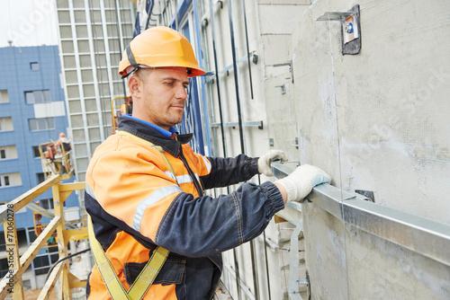 builder at facade construction work - 71060278