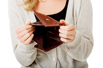 Young caucasian woman with empty wallet