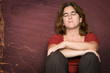 Sad and depressed woman sitting on the floor