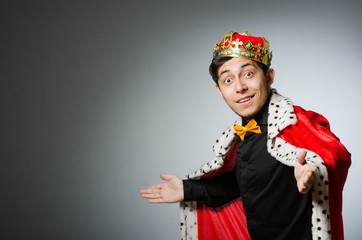 Concept with funny man wearing crown