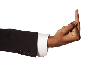 dark skinned hand in suit showing middle finger