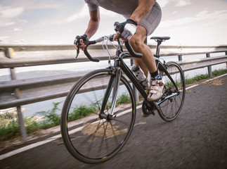 Detail of a road bike with a cyclist pedaling