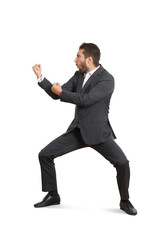 funny businessman beating his fist
