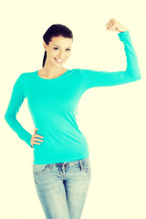 Young woman shows her biceps.