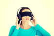 Blindfold attractive woman with headphones