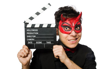 Devil with movie board isolated on white