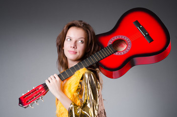 Guitar player with red instrument