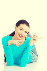 Young woman pointing on copy space
