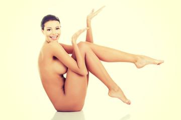 Attractive nude woman presenting copy space.