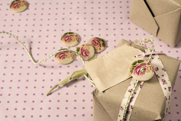 Gift wrapped in recyclable paper, ribbons, decorated with wooden
