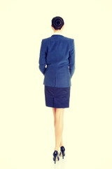 Rear view of young beautiful businesswoman