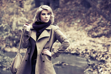 Happy young fashion woman in autumn forest