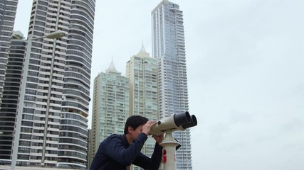 7of10 Asian business man with binoculars