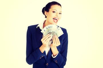 Happy businesswoman holding euros