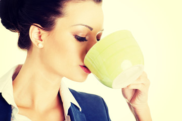 Businesswoman having coffee / tea break