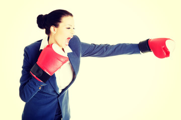 Attractive businesswoman with boxing gloves