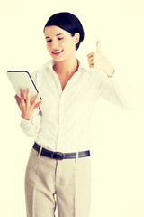 Business woman holding tablet computer.