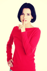 Woman making a keep it quiet gesture