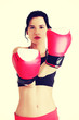 Boxing fitness woman wearing red gloves.