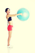 Beautiful young woman with pilates exercise ball.