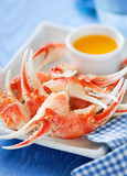 Boiled crab claws with orange sauce, selective focus