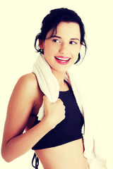 Woman in sports clothes with towel on neck