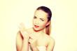 Portrait of a beautiful female model applying cream