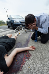 Bleeding woman on the pedestrian crossing