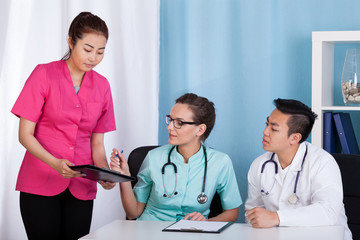 Asian and caucasian doctors during job
