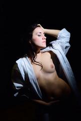 Beautiful girl in studio topless