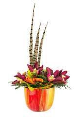 Bouquet from artificial orchid flowers and feathers of pheasant.