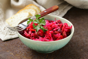 Russian salad of beetroot and pickled cabbage (vinigret)