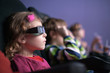 girl 3D wearing spectacles watches movie at movie theater