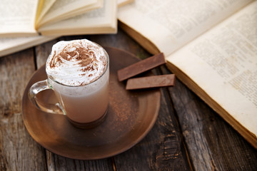 Chocolate with whipped cream with books in the background