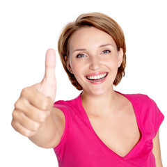 Portrait of a beautiful adult happy woman with thumbs up sign