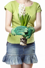 Young woman holding white hyacinth flower