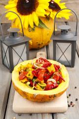 Vegetable salad served in pumpkin