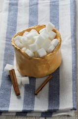 Cubes of sugar in rustic bowl