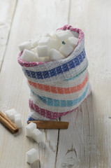 Cubes of sugar in canvas bag