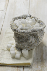Cubes of sugar in burlap bag
