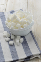 Cubes of sugar in white bowl