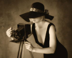 Girl-photographer with old camera