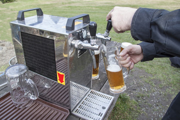 pouring beer into the glass, garden celebration