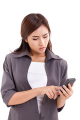 upset business woman using, texting with smartphone